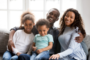 Portrait of happy large African American family at home sitting on couch