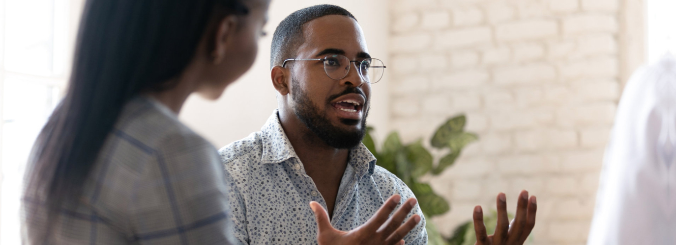 african american male psychologist meeting patients at group therapy