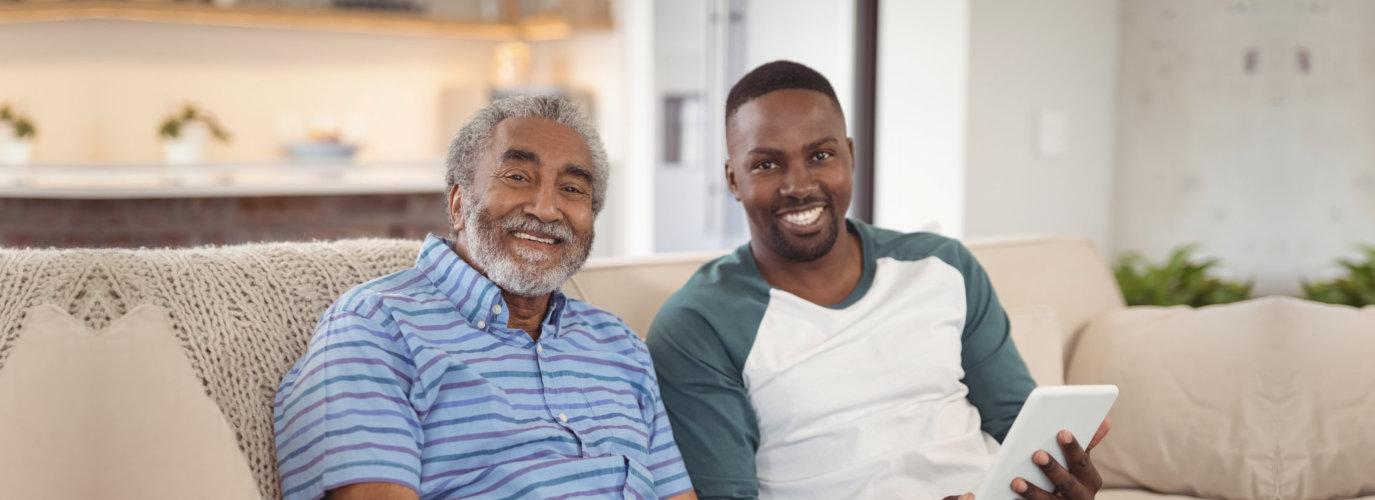 senior man and adult man smiling
