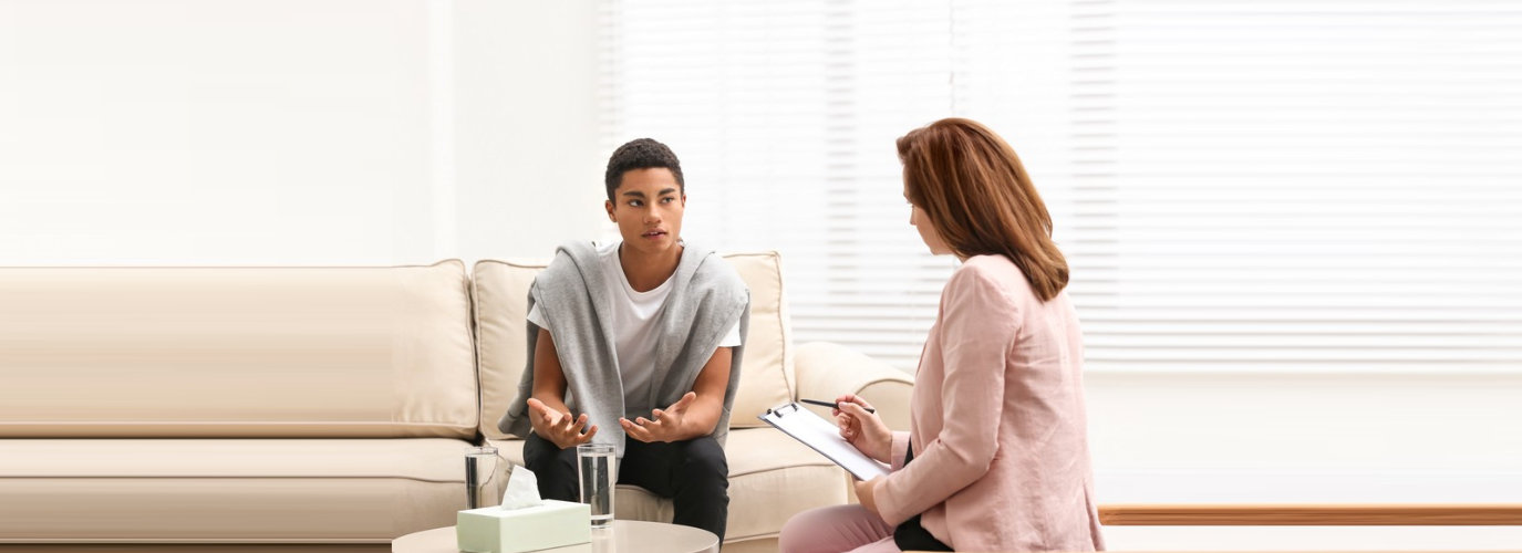 young man talking to adult woman